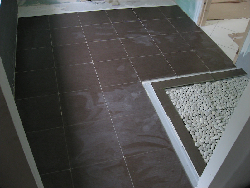 Poser carrelage sol salle de bain for Pose carrelage sol